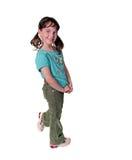 Junges Schule-Alters-Kind auf dem weißen Lächeln Lizenzfreie Stockbilder
