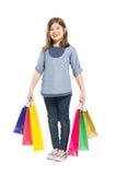 Junges und frohes Einkaufsmädchen Lizenzfreies Stockbild