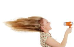 Junges weibliches trocknendes Haar lizenzfreies stockfoto