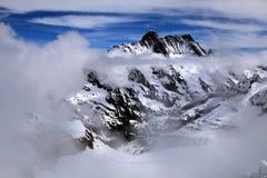 Jungfrau, la Svizzera e cloudscape Immagini Stock Libere da Diritti