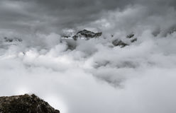 Jungfrau north face peaking from beneath the clouds Royalty Free Stock Photo