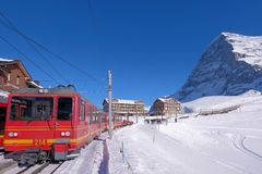 Jungfrau railway train station at Kleine Scheidegg to Jungfraujoch, north face of mount Eiger in background, Switzerland. The Jungfrau railway train station at royalty free stock photography