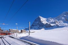Jungfrau railway train station at Kleine Scheidegg to Jungfraujoch, north face of mount Eiger in background, Switzerland. The Jungfrau railway train station at royalty free stock images