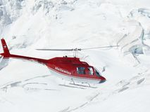 Jungfrau, Switzerlan, 08/06/2009. Red helicopter on high mountai stock images