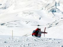 Jungfrau, Switzerlan. Red helicopter on high mountain snow royalty free stock images