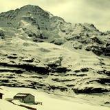Jungfraujoch - överkant av Europa i schweiziska fjällängar Royaltyfri Foto