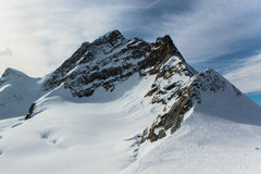Jungfraujoch, parte de la montaña alpina de la nieve de las montañas suizas Imágenes de archivo libres de regalías