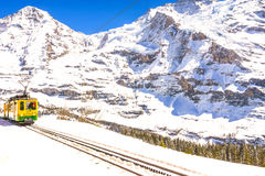 Jungfraujoch, Switzerland - April 29, 2017: Old style trains among the mountains near Kleine Scheidegg Station at Jungfrau, Switze. Rland stock photography