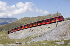 Jungfraujoch, Switzerland - August 22, 2015: Famous cog wheel Train Royalty Free Stock Photos