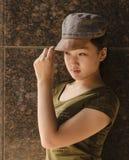 Jungfru som bär en hatt Arkivbild