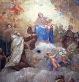 Jungfruliga Mary med behandla som ett barn Jesus och Carmelite helgon Arkivbilder