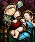 Jungfruliga Mary med behandla som ett barn Jesus och St John Arkivbilder