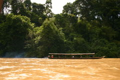 Into the jungle. Wooden boat up the river to the heart of the jungle of Taman Negara Stock Images