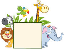 Jungle Animals Behind A Blank Sign With Leaves Royalty Free Stock Image