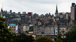 Jungle of chimney stacks and roofs in Edinburgh's Old Town, Scot. Edinburgh, Scotland - September 14, 2014: panorama of Edinburgh's Old Town full of canted roofs Stock Photo