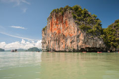 Jungle covered limestone cliffs Stock Photography