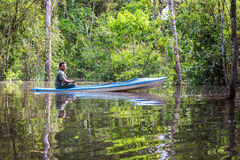Jungle Guide in a Canoe Stock Photo
