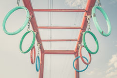 Jungle gym rings and chains, vintage color toned Royalty Free Stock Photography