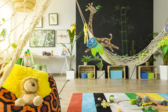 Jungle kids room with hammock stock photo