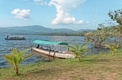 Jungle lake and tourist boats. A jungle boat in the sun with a blue sky in the background at laguna azul, sauce, laguna azul, tarapoto, san martin, Peru royalty free stock photography