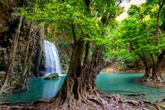 Jungle landscape with flowing turquoise water of Erawan cascade waterfall at deep tropical rain forest. National Park Kanchanaburi. Thailand Stock Image