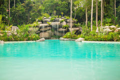 Jungle landscape with wonderful blue lagoon, Thailand. Jungle landscape with wonderful blue lagoon and flowing turquoise water cascade waterfall at deep tropical Royalty Free Stock Images