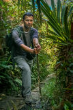 On the jungle path. Man on the jungle path towards one of the volcanoes in Sumatra, Indonesia Stock Photography