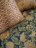 Jungle Prints. Leopard print pillows om jungle print cover Royalty Free Stock Photography