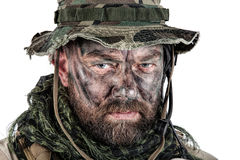 Jungle warfare closeup. Special forces United States in Camouflage Uniforms studio shot. Wearing jungle hat, Shemagh scarf, painted face. Studio shot isolated Royalty Free Stock Photo