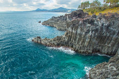 Jungmun Daepo coast with columnar joints at Jeju Island, South K Royalty Free Stock Photos