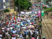 1. Juni Protest im Regen - 2013, Hong Kong Stockbild