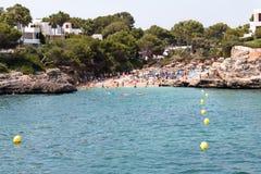 Juni 16th, 2017, Cala Egos, Mallorca, Spanien - sikt av stranden och dess omgivning Arkivbilder