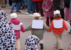 Junior advertisers. Three young children on parade with advertising space on their backs Stock Photography