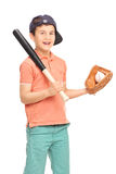 Junior baseball player holding bat and a ball Stock Images