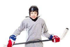 Junior Boy Ice Hockey Player a isolé sur le fond blanc photo libre de droits