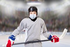 Free Junior Boy Ice Hockey Player Wearing Face Mask In New Normal After Covid-19 Stock Image - 184015461