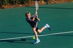 Junior Boy Tennis Back-Hand Stroke Royalty Free Stock Images
