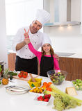 Junior chef beautiful girl and master teacher award winner Royalty Free Stock Image