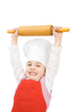 Junior cook. A little cook with rolling pin Stock Image