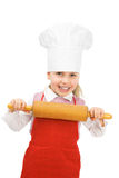 Junior cook. A little cook with rolling pin Royalty Free Stock Image
