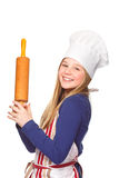 Junior cook with rolling pin smiling Royalty Free Stock Image