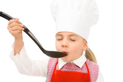 Junior cook tasting copyspace on spoon Royalty Free Stock Photos