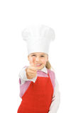 Junior cook thumb up. A little cook with chef�s hat and thumb up Stock Photo