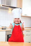 Junior cook thumbs up Stock Photos
