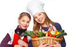 Junior cook with vegetables smiling Stock Photo