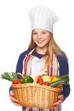 Junior cook with vegetables smiling Stock Photos