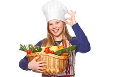 Junior cook with vegetables smiling Royalty Free Stock Image