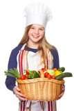 Junior cook with vegetables smiling Royalty Free Stock Photos