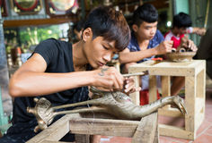 Junior craftsmen making copper handicraft products in traditional way Stock Photos