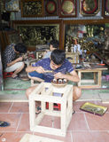 Junior craftsmen making copper handicraft products in traditional way Royalty Free Stock Image
